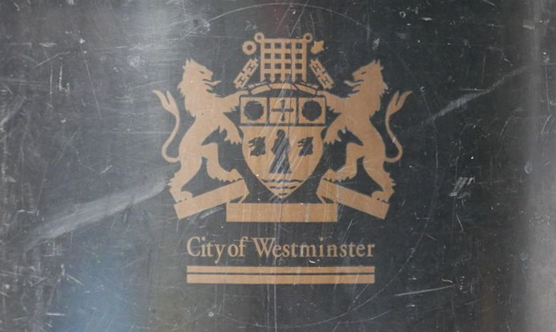Bin with Westminster Council logo.