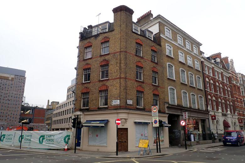 Victorian building on street corner.
