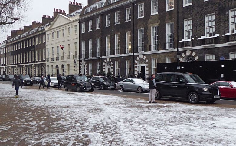 Taxis parked on the pavement on Bedford Square.