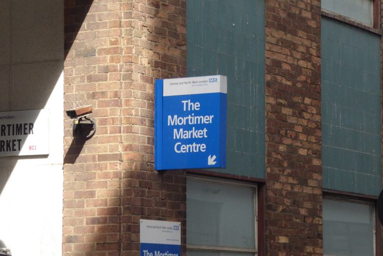 Sign directing people to The Mortimer Market Centre.