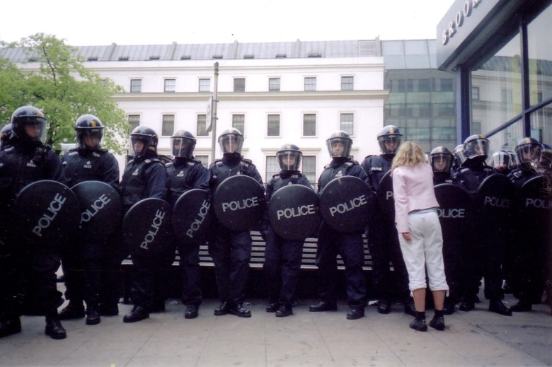 Line of police in riot gear.
