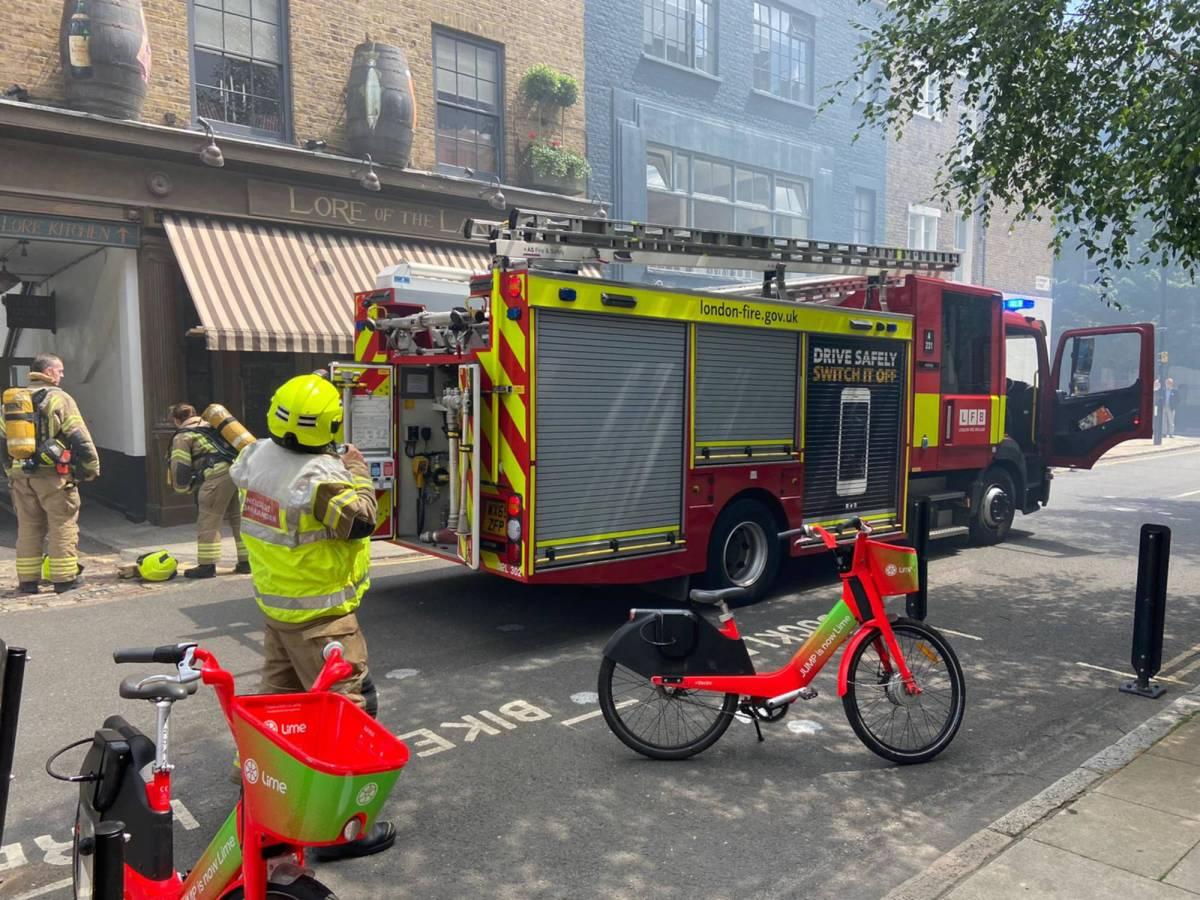 Fire crews outside pub.