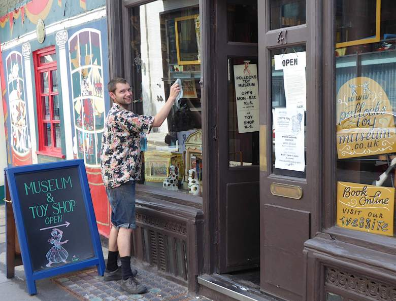 Jack Fawdry gives the windows of the Toy Museum and Shop a polish.