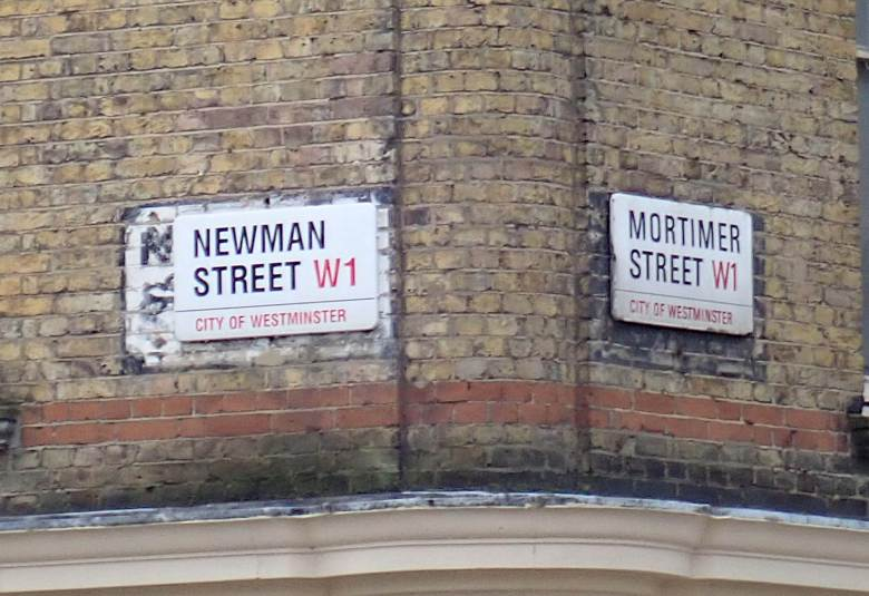City of Westminster street signs for Newman Street and Mortimer Street in Fitzrovia.