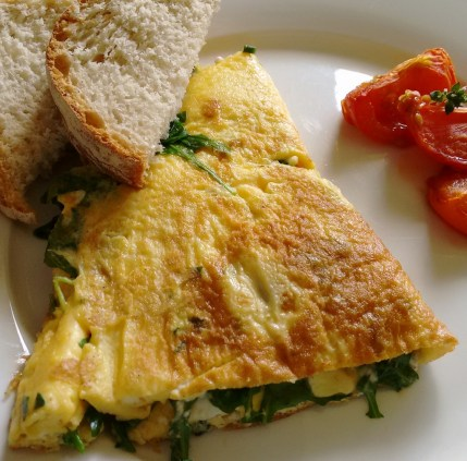 goat cheese omelette with bread and roasted tomatoes