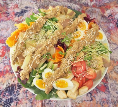 Delicious nut free satay sauce dolloped onto the Indonesian style salad gado gado