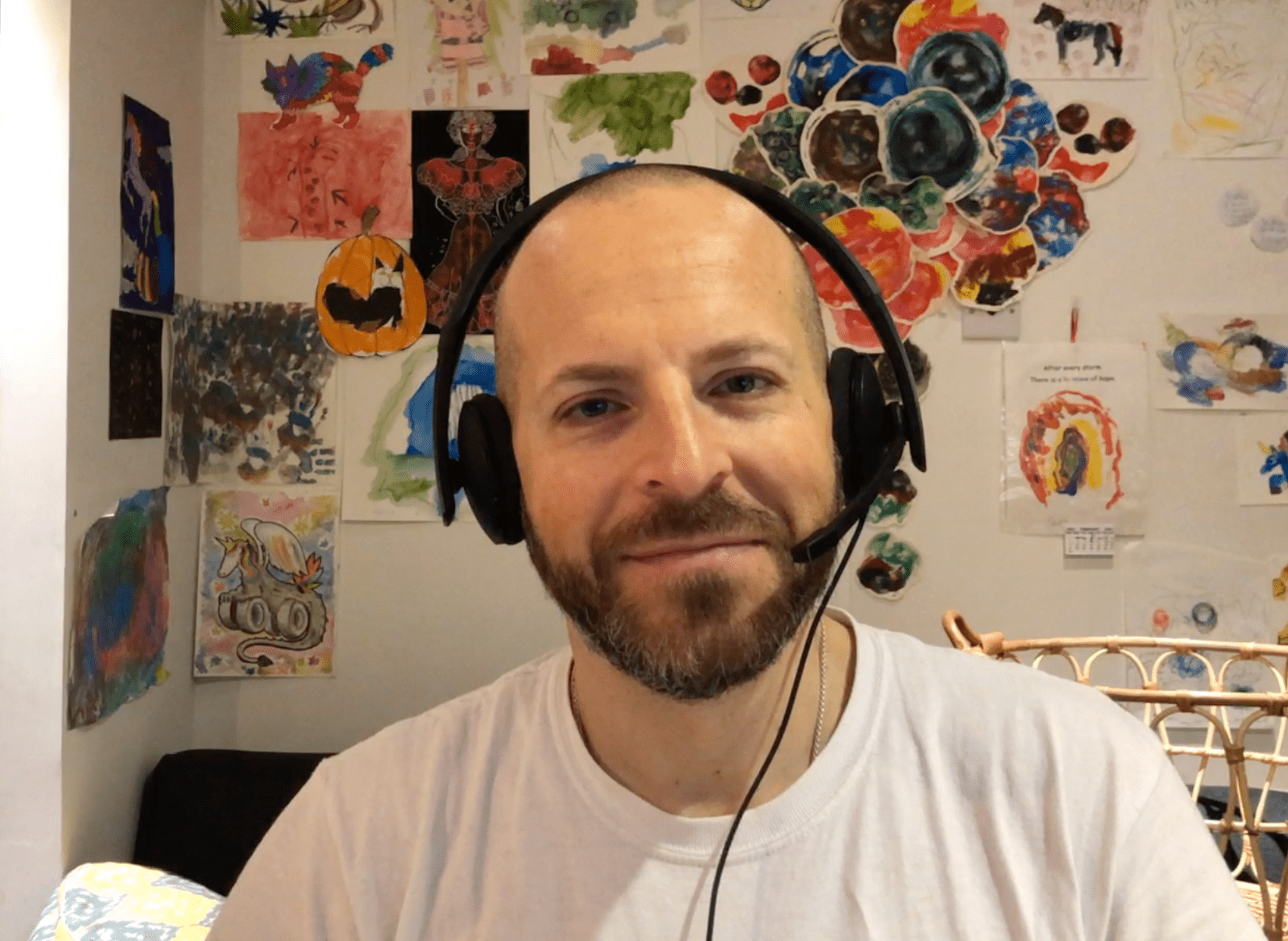 Portrait of me with headset looking at the camera in Zoom.