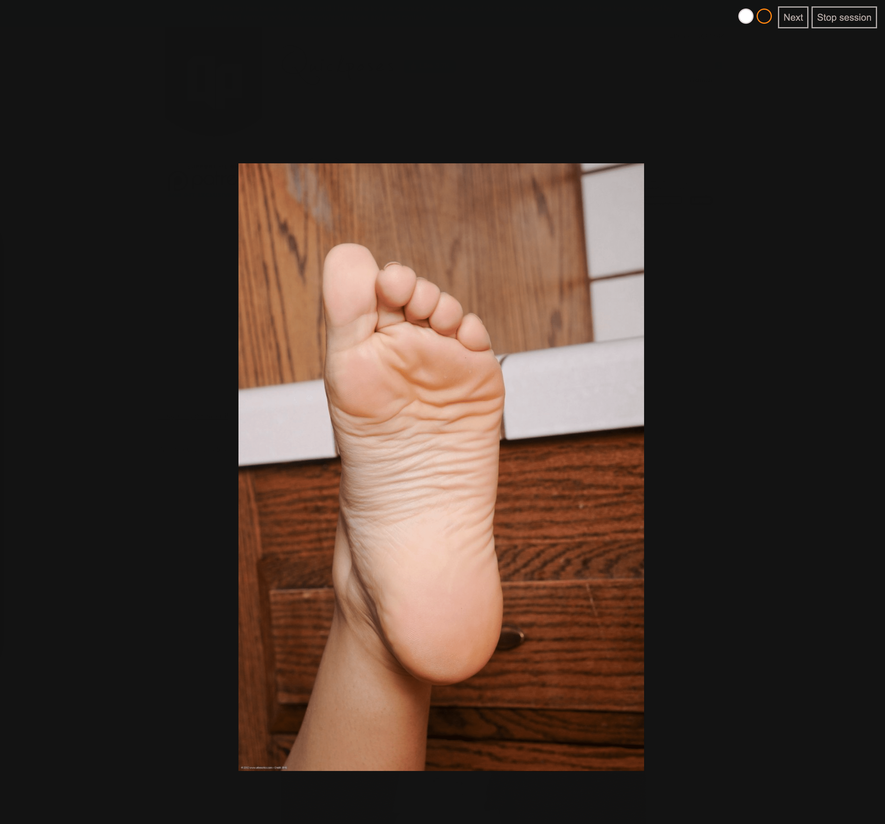 Screenshot of a hoot of a foot stretched upwards.