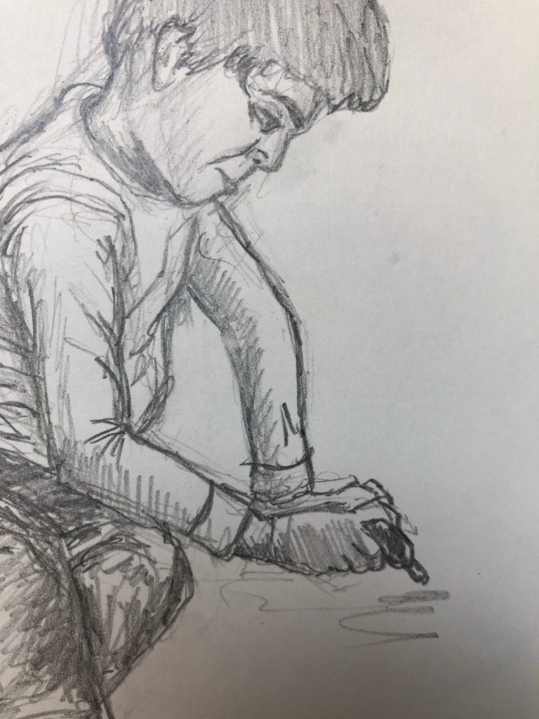 Close-up of pencil drawing of face and arms.