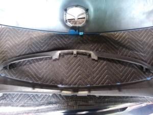 The lower bumper trim piece.