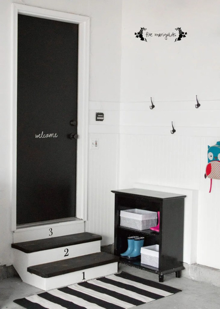 I can't believe the difference this garage to mudroom transformation made on such a small budget!