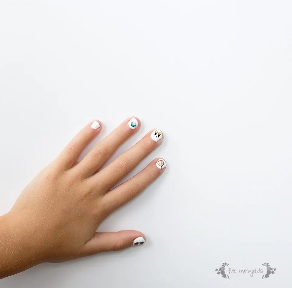 Why didn't I think of that? Use tattoos as nail art. Free Printable Halloween Emoji Nail art.