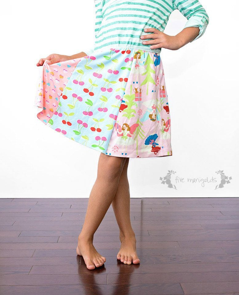 Such a good idea! Refashion upcycled T-shirts to create a custom knit dress for little girls. Upcycled t-shirt dress tutorial| Five Marigolds