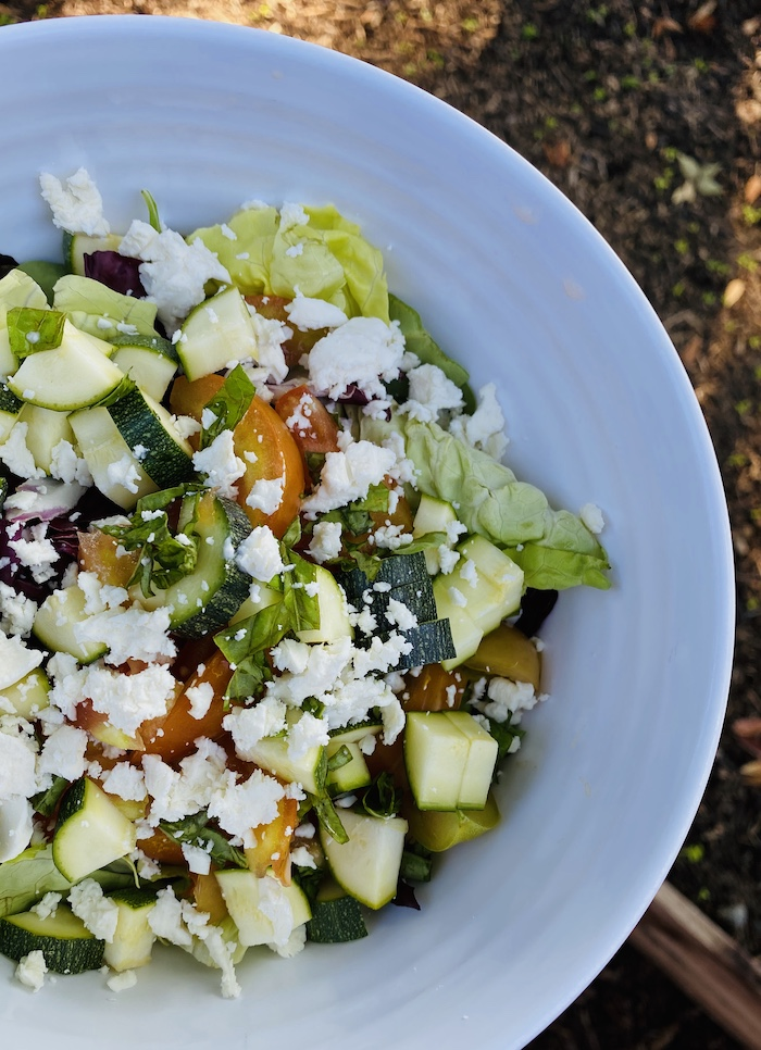 Easy summer garden salad with zucchini, tomato, basil, goat cheese, butter lettuce.