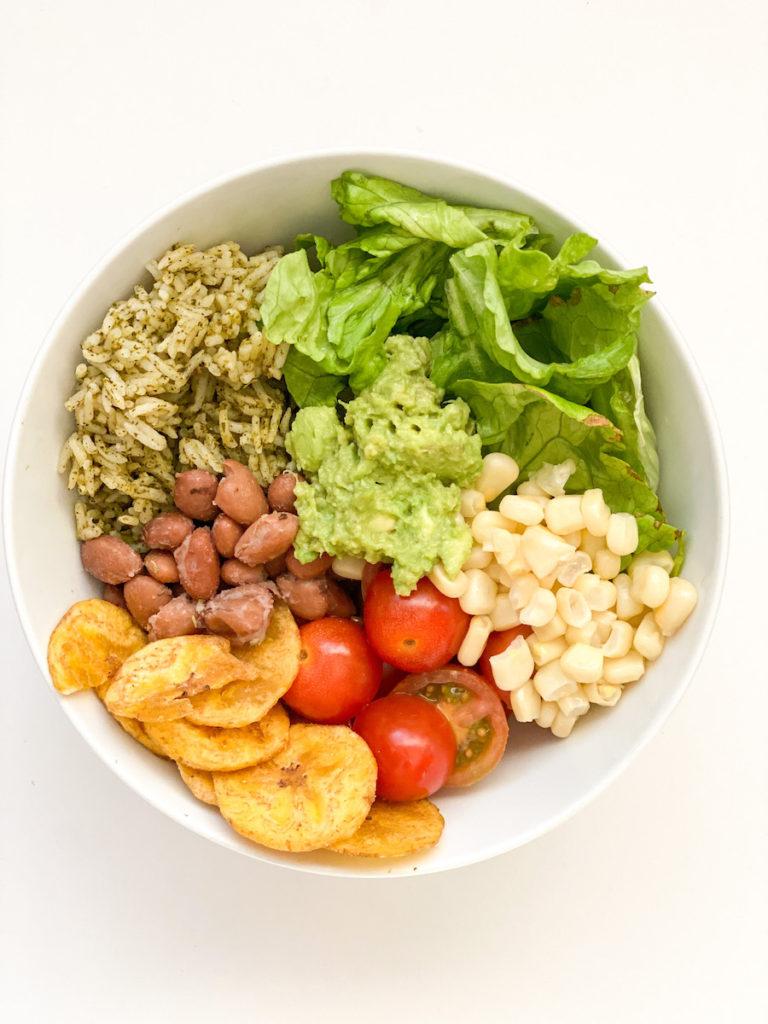 pinto bean cilantro rice corn guac plantain chips burrito bowl. spring meal plan recipe from fiveplates.com