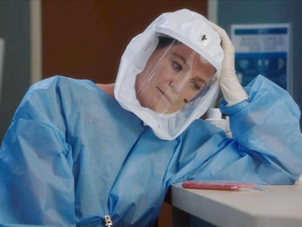 Meredith Grey in full PPE takes a short break.