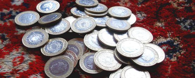 £2 coins, wealth, success
