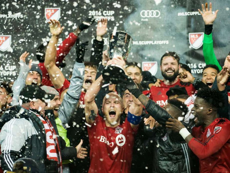 Captain Michael Bradley lifts the MLS Eastern Conference Cup with Toronto FC