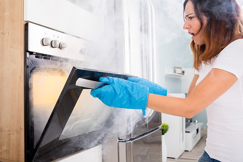 self-cleaning oven smokes