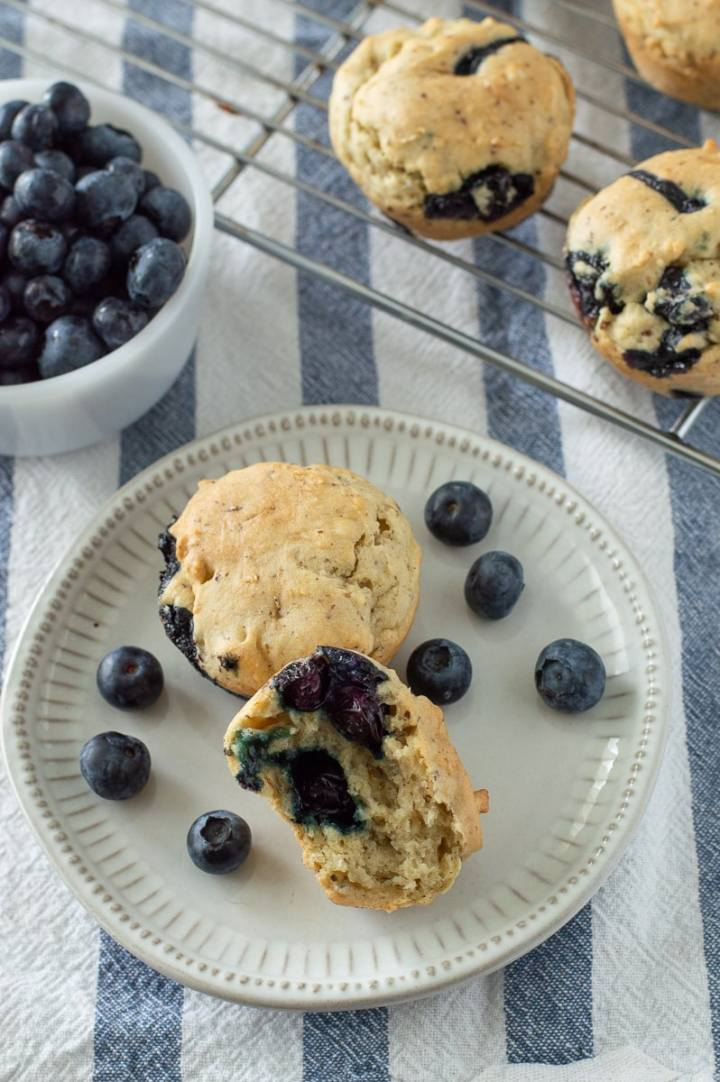 Vegan gluten free blueberry almond muffins are a great healthy breakfast for busy days. Make these to grab and go or freeze them for a make ahead breakfast later!