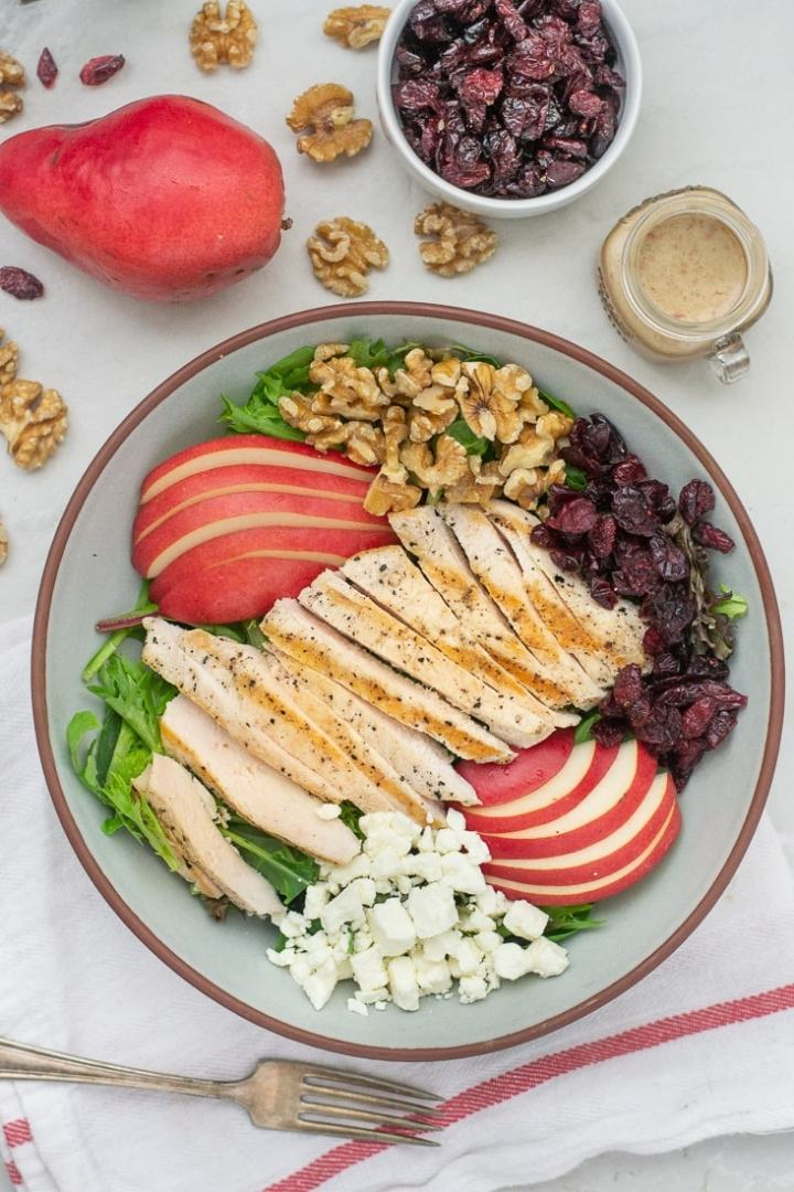 Pear Cranberry Chicken Salad is an easy healthy lunch or dinner that is great for fall. This salad can be made for under $4 and tastes amazing!