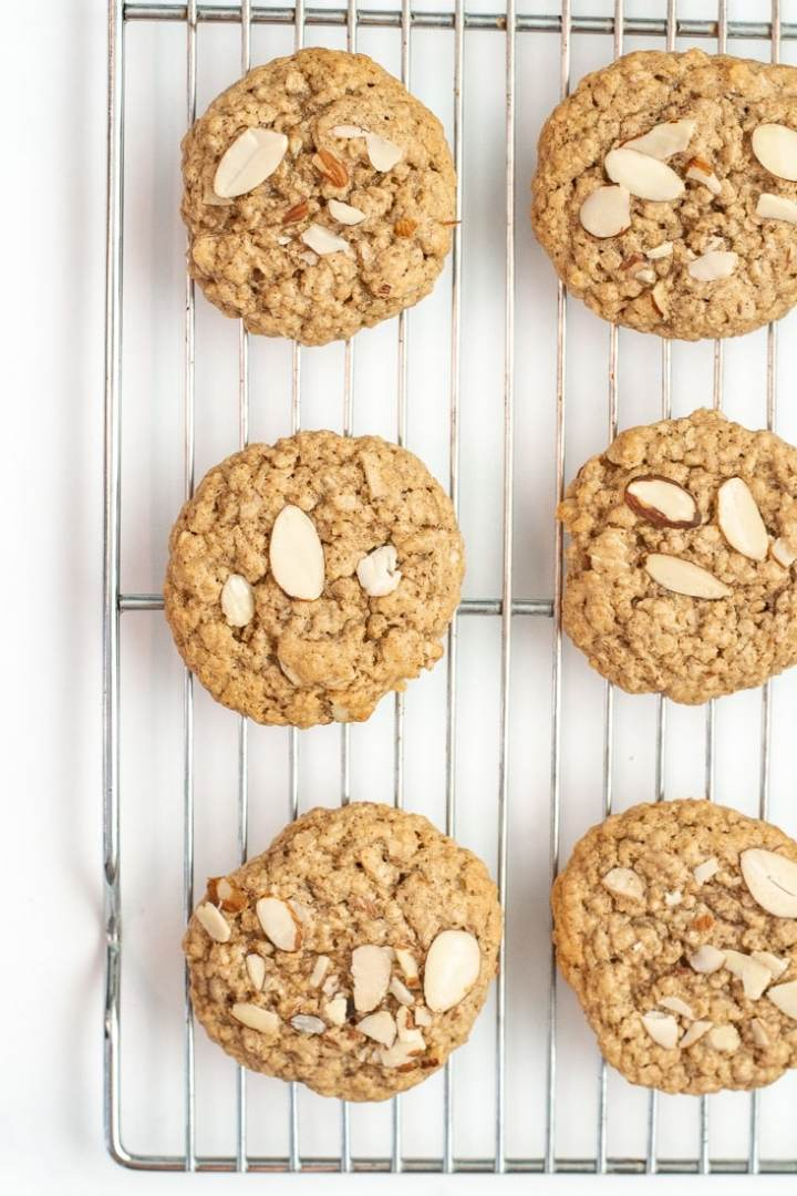 Gluten Free Almond Butter Oatmeal Cookies are low calorie and a healthy version of your typical oatmeal cookie because they are dairy free and free of refined sugars as well! #glutenfree #oatmealcookies #healthycookie #lowcalorie #refinedsugarfree #dairyfree