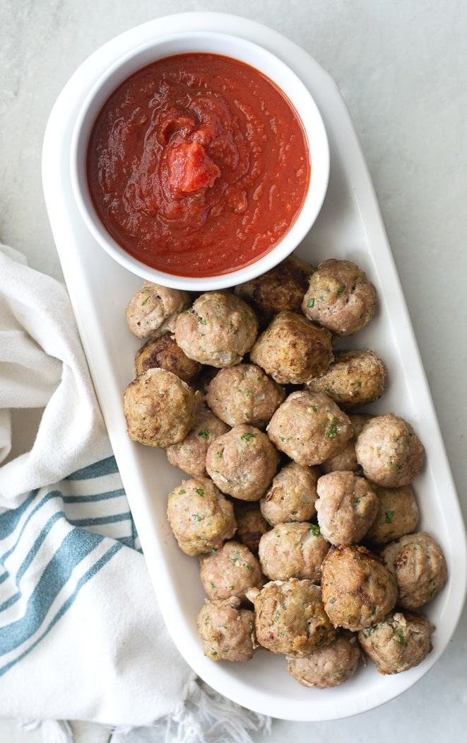 Healthy baked Whole30 Turkey Meatballs is an awesome recipe to have on hand for meal prepped lunches, dinners, and even appetizers for company. These are made without breadcrumbs, so bake an extra batch to freeze while you're at it! #turkey #whole30 #paleo