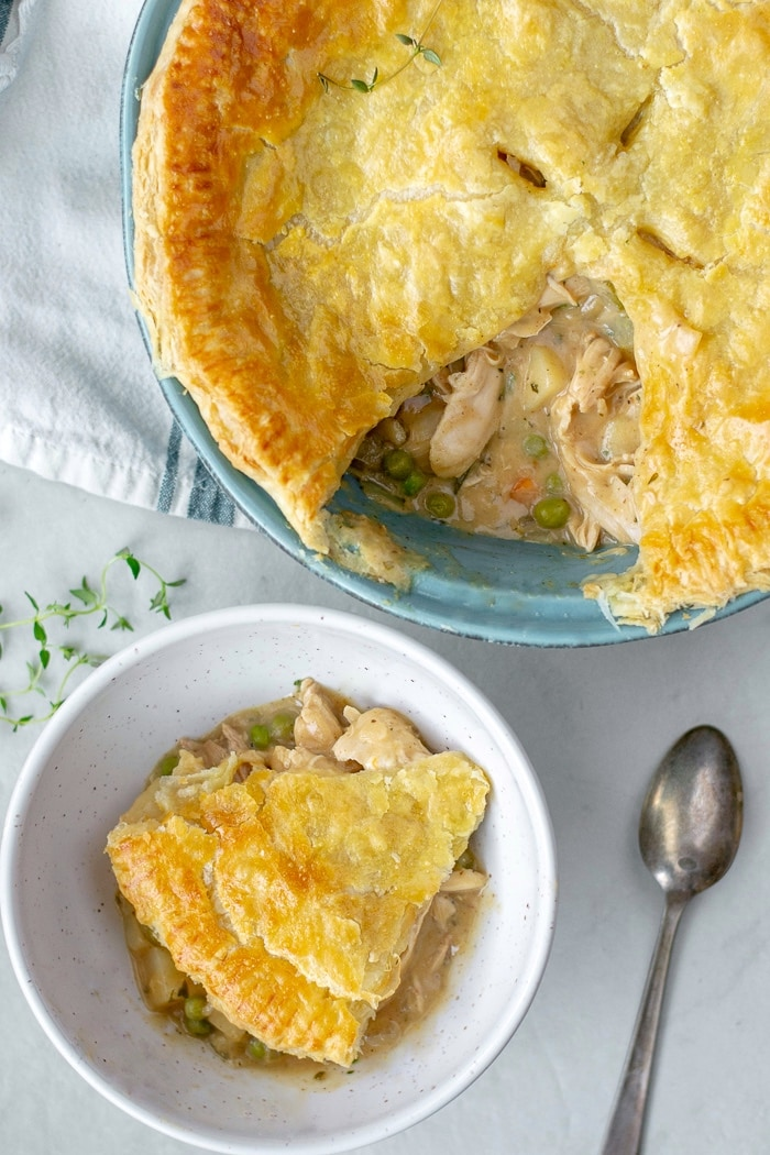 Easy to make Turkey Pot Pie Recipe with loads of veggies and leftover chicken or turkey. The crust is a flakey puff pastry which makes if a quick a delicious weeknight dinner. #potpie #turkeyleftovers