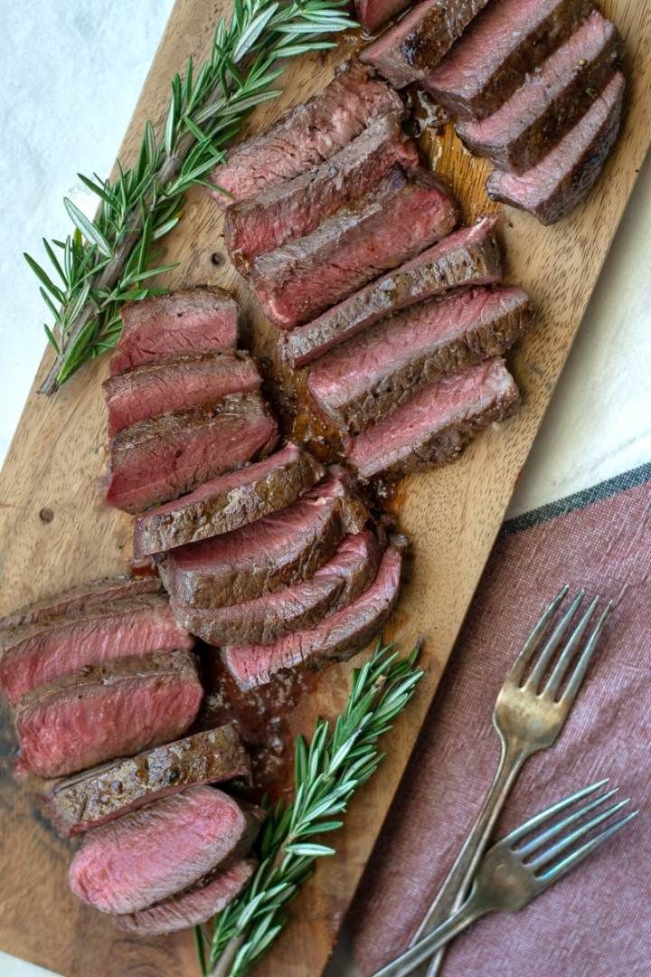 Simple cast iron steak is both keto, paleo and whole30. Learn how to cook sirloin steak on the stovetop. It's the perfect meal prep recipe. #keto #paleo #whole30