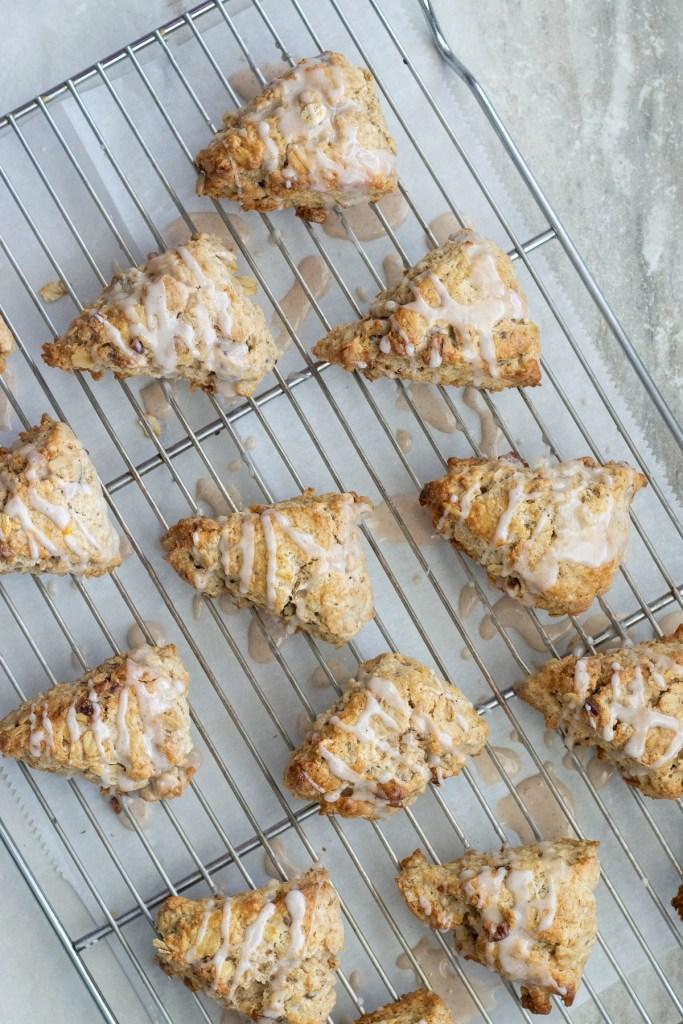 Glazing oatmeal pecan scones with cinnamon glaze.