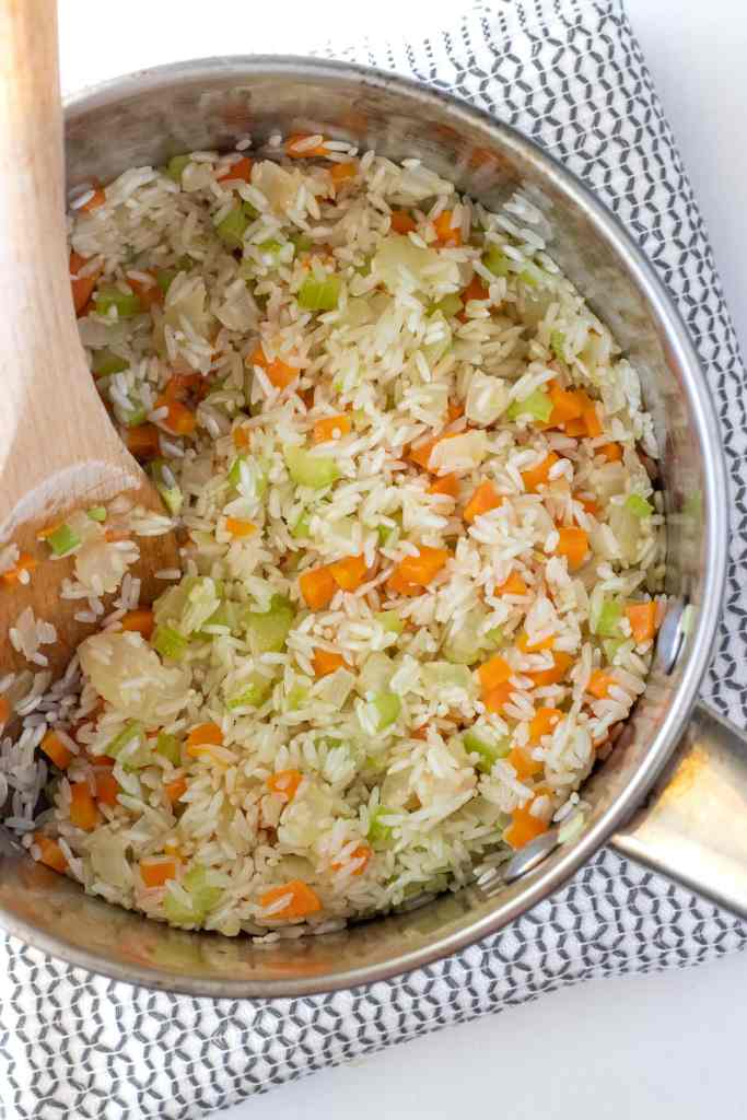 Add the rice and coat in butter, saute the rice until it starts to become translucent.