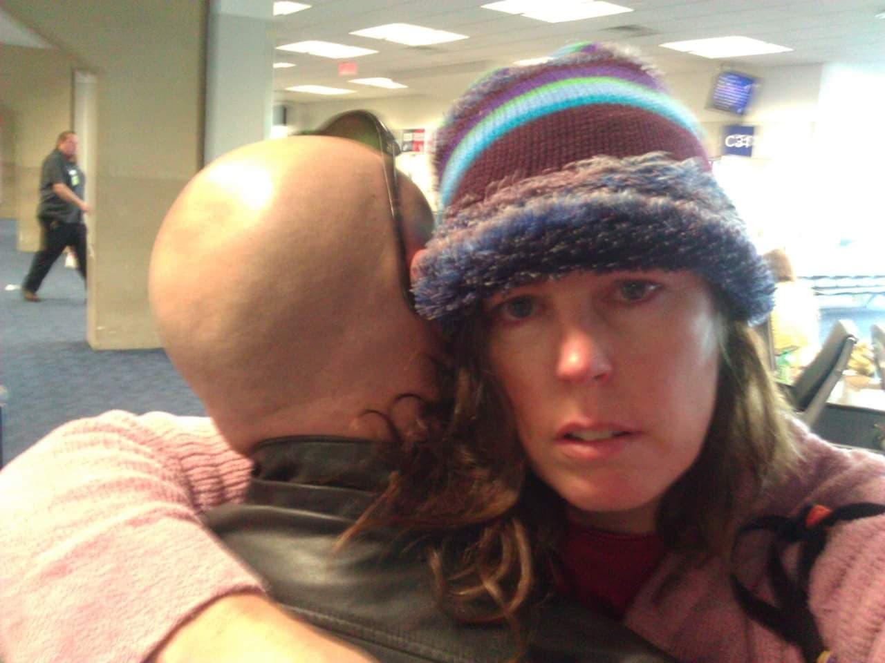 Sherry Palmer hugging Ron B Palmer
