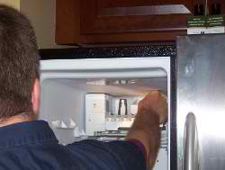 Refrigerator Repairman Fixing Ice Maker