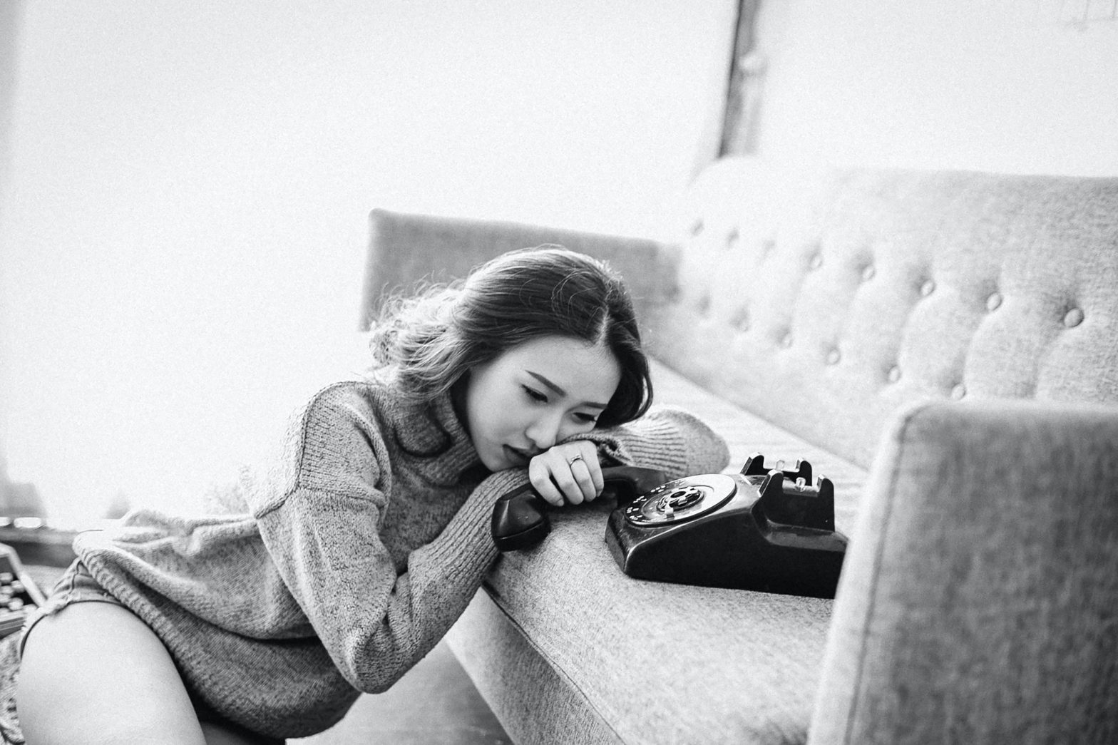 Woman waiting by the phone to symbolize codependency