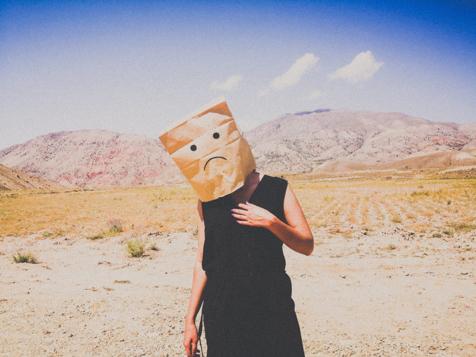 """Guy with a paper bag over his head with a frowny face on it, thinking, """"You make me feel sad."""""""