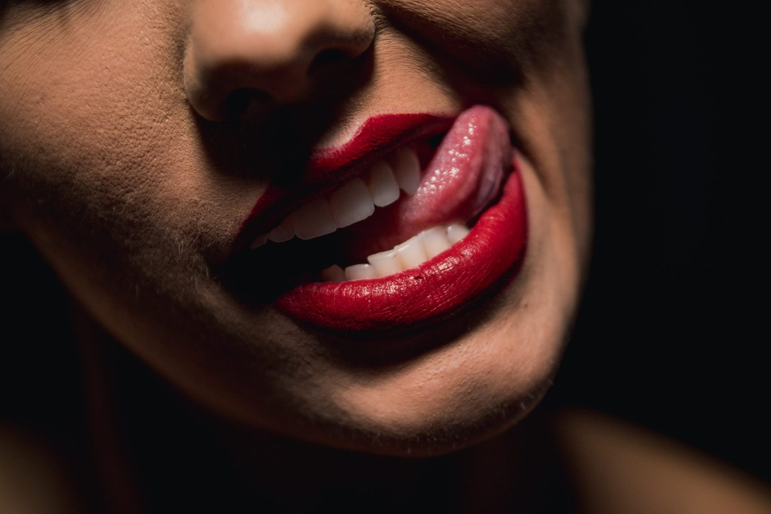 Mouth with red lipstick and tongue sticking out. Instant love, just add sex.