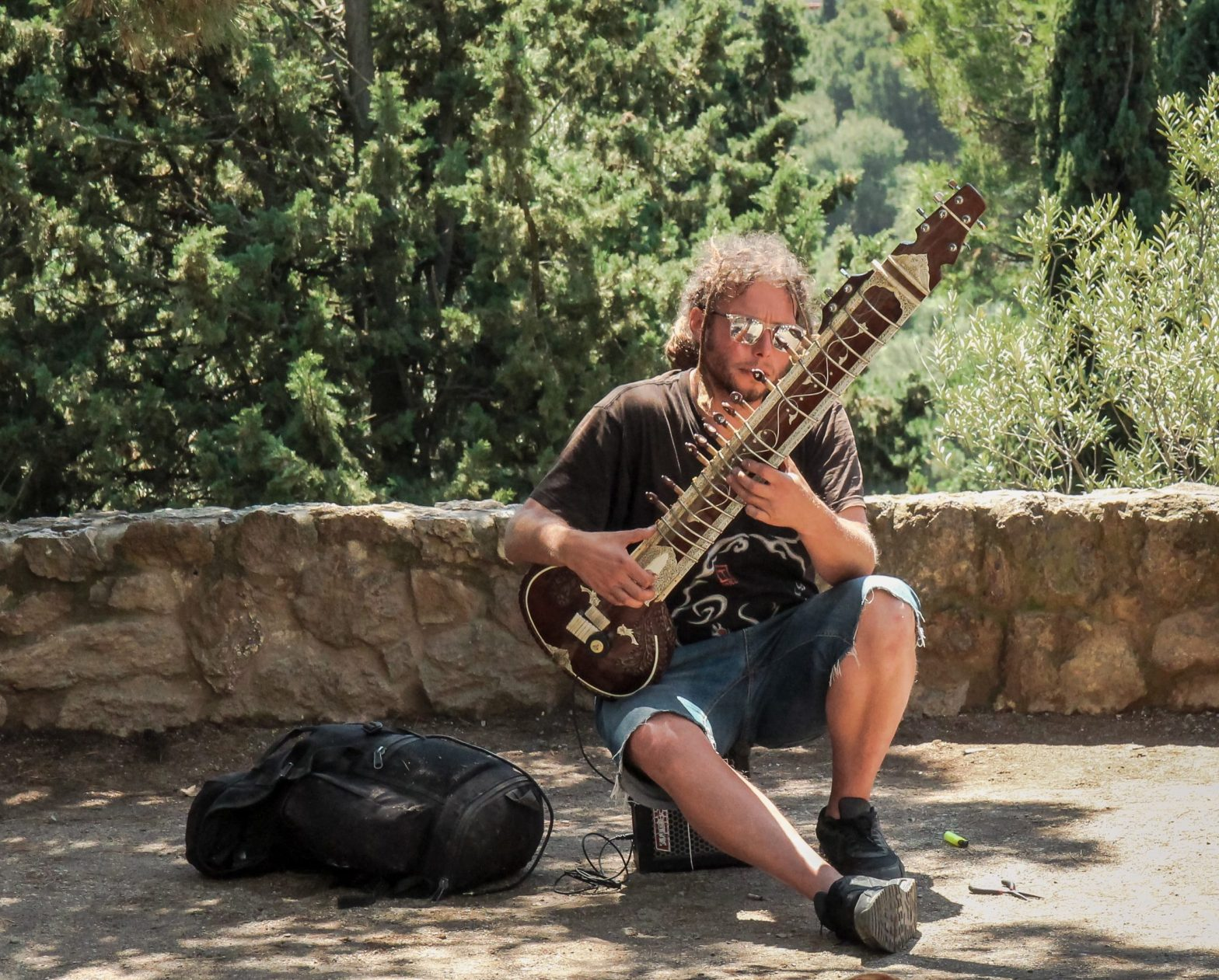 Dude sittin on an amp playing a sitar –authenticity