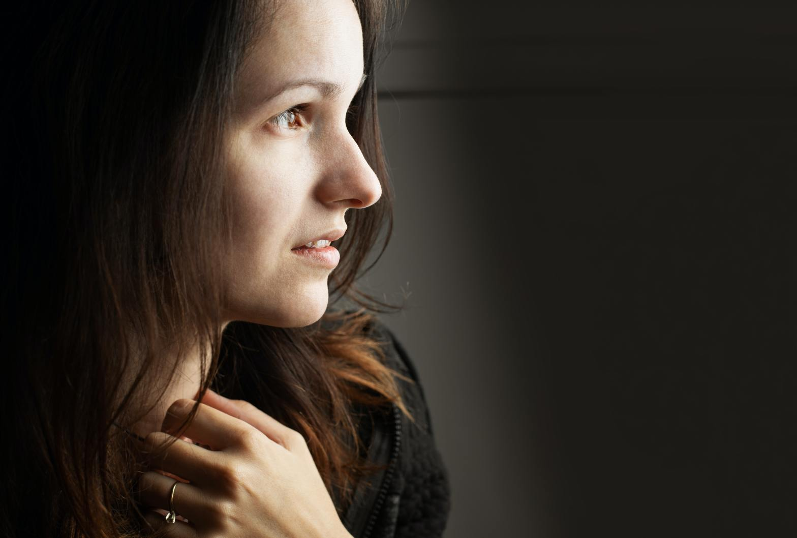 Woman looking apprehensive–when relationships don't feel safe