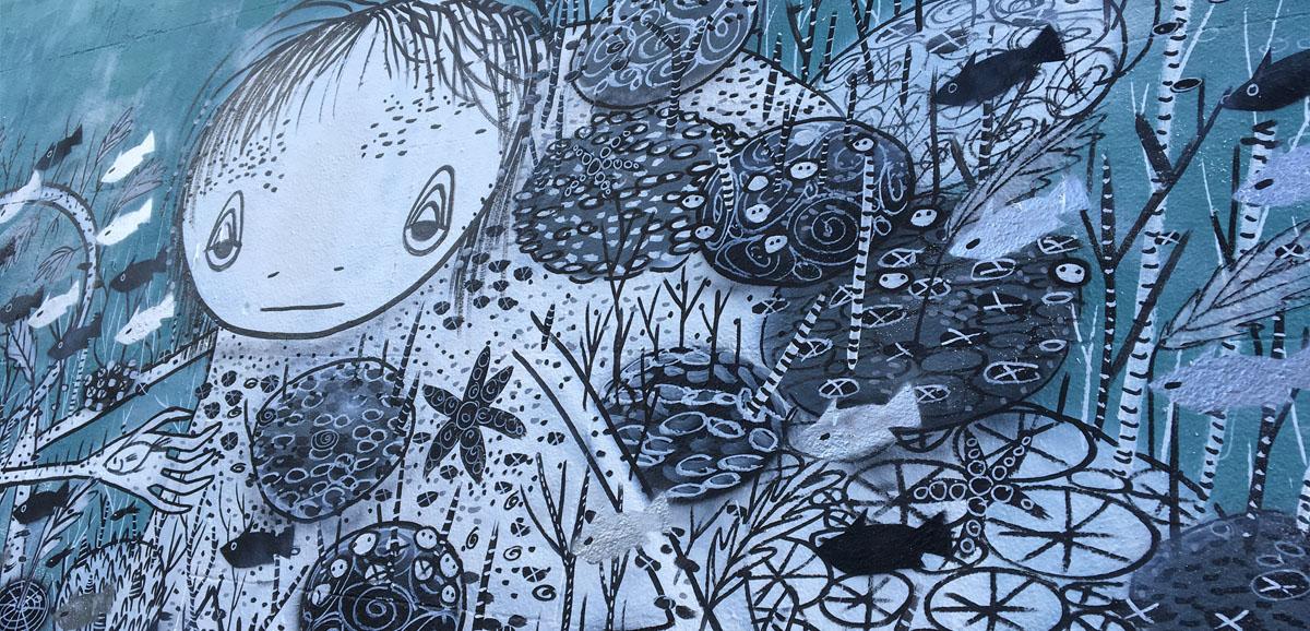blue graffiti of beautiful line drawn girl in the sea - painted on Wellington St Collingwood, near Johnston St