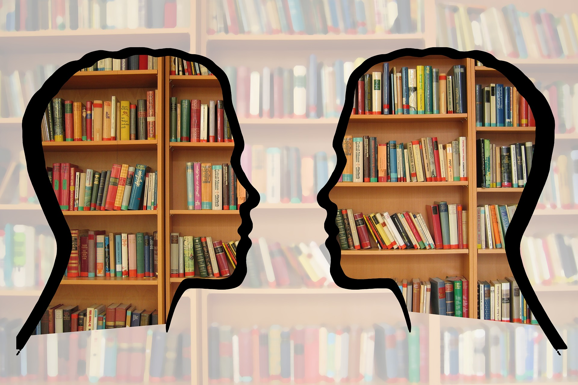 silhouette of faces over layer of library books