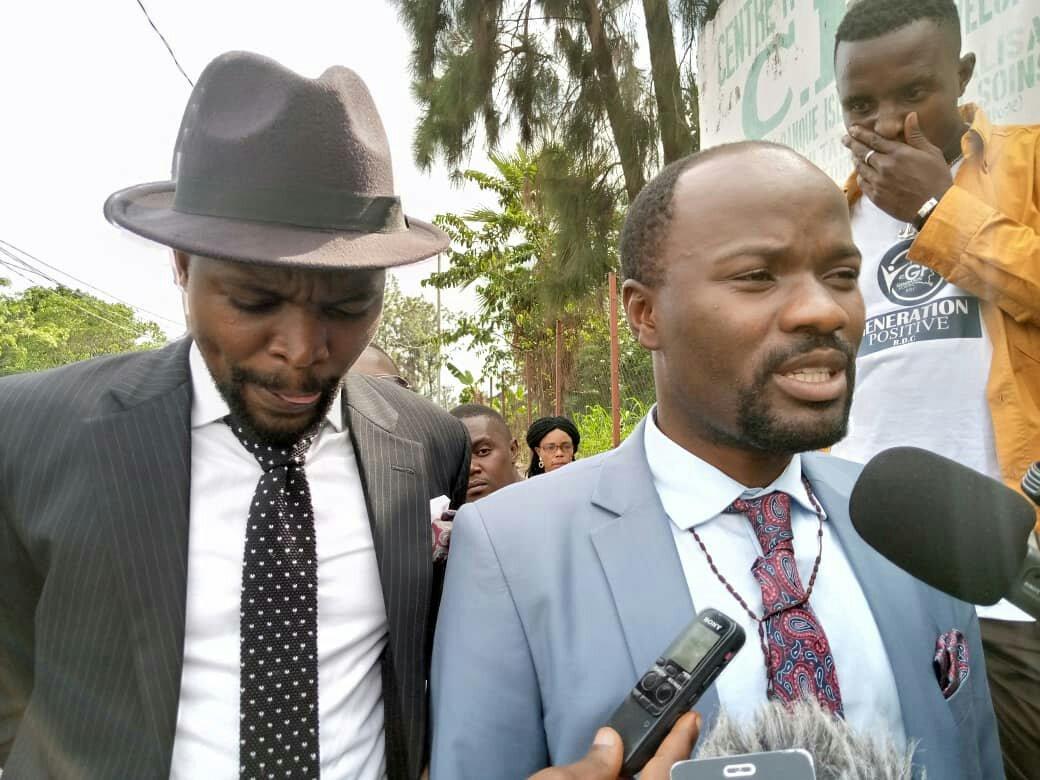 ©Ph David Lupemba, Vu Me Saïdi Balikwisha et son client devant la presse après l'audition.