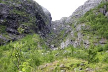 The path runs up the lower ridge to the left