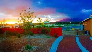 The FALA campus at sunset with the San Francisco peaks in the background
