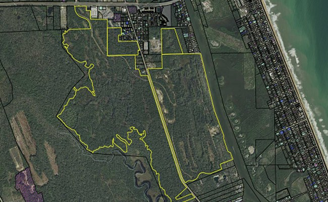 SunBelt Land Management bought nearly 3,000 acres straddling John Anderson Highway some 13 months ago, for $11.5 million, where the Garden Development is planned. The project had previously been marketed by Bobby Ginn/Lubert-Adler as The Gardens at Hammock Beach.