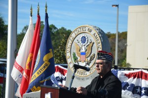 County Commission Chairman George Hanns, an Army sergeant, was master of ceremonies at today's commemoration of Veterans Day. (© FlaglerLive)