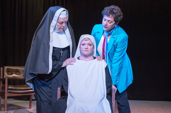 """The death of a newborn baby at a convent spurs a battle of wills – and faith – in the City Repertory Theatre production of """"Agnes of God."""" The play stars, from left: Nancy Howell as the Mother Superior, Chelsea Jo Conard as Sister Agnes and Julia Davidson Truilo as the psychiatrist Martha Livingston. The play runs May 4-13 at City Rep's venue in Palm Coast. (Mike Kitaif)"""
