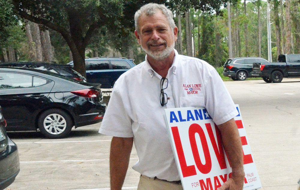 Alan Lowe, a candidate for Palm Coast mayor, at the end of the second day of early voting at the public library in Palm Coast today. (© FlaglerLive)