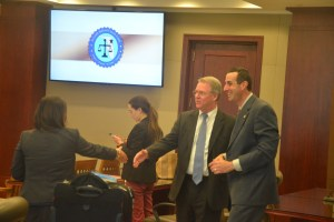 It was not the most amicable battle of attorneys during four days of trial, but after the jury went in to deliberate, Assistant State Attorneys Charlene Sullivan, left, and Jason Lewis, right, shook hands with Kevin Kulik, the defense attorney. His partner, Ashley Kay, is in the background. Click on the image for larger view. (© FlaglerLive)