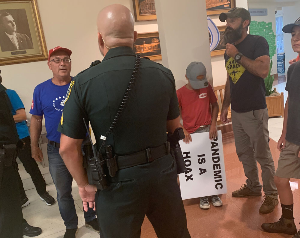 A scene at the Aug. 17 school board meeting in Bunnell. The meeting had to be recessed for half an hour because of hostility and chaos. (© FlaglerLive)