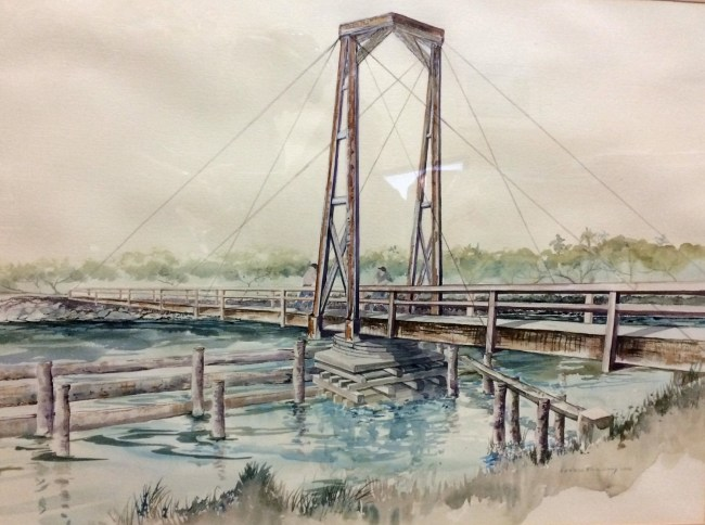 A beautiful original watercolor by Barbara Klein Craig, painted in 1992, of an old turnstile bridge over the Intracoastal. Flagler Beach Commissioners personally bought the watercolor at the Carver Gym Auction to benefit the Carver Center. The painting will now hang in Commission chambers in perpetuity. (© FlaglerLive)
